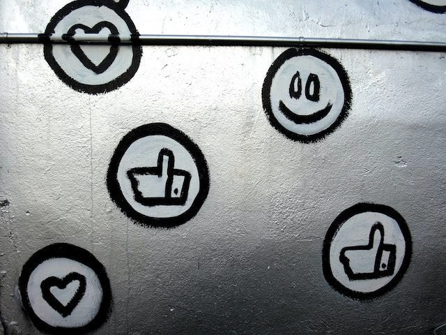 painted icons indicating social media engagement on a silver background