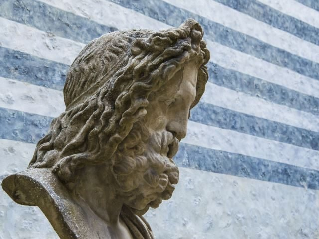 Bust of Zeus, king of the gods, with striped background